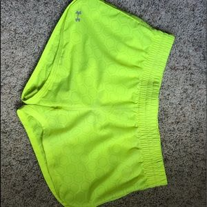Neon yellow Under Armour athletic shorts